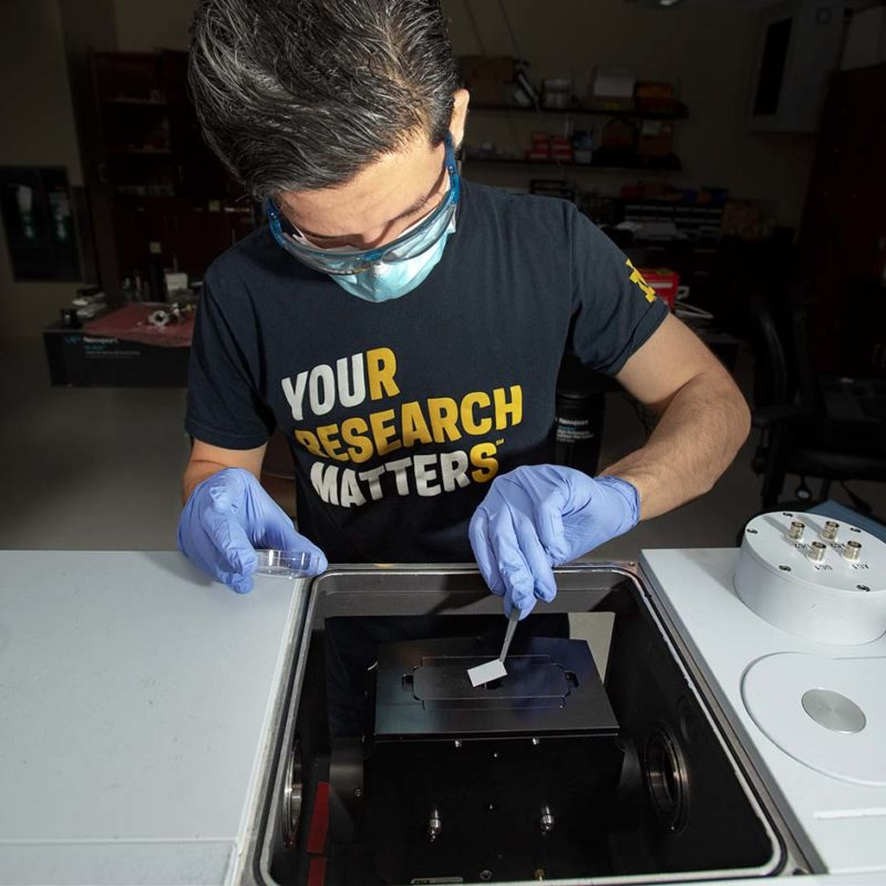 Electrical Engineering Ph.D. student Irfan Khan working in Professor Anthony Hoffman's Photonics Lab