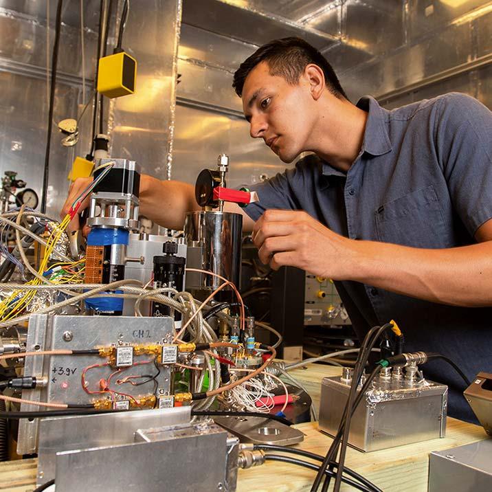 Summer REU Student conducting research